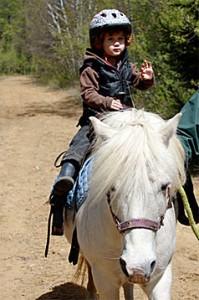 Girl on a white pony